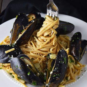 "<span class=""entry-title-primary"">Mussels over Linguine with Garlic Butter Sauce Recipe</span> <span class=""entry-subtitle"">A KS fav—steamed mussels served over linguine in a cream-based garlic butter and wine sauce.</span>"