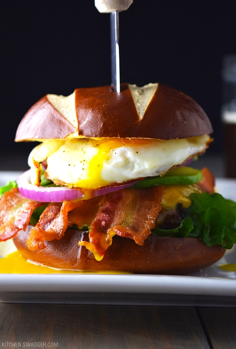 Bacon, Egg, and Avocado Cheeseburger on a Pretzel Bun