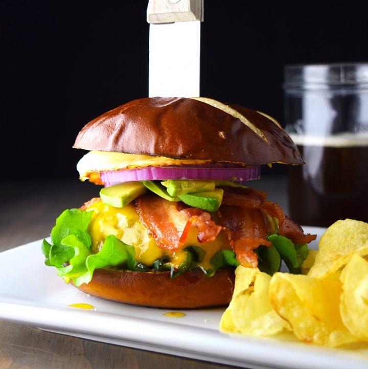 Bacon, Egg, and Avocado Cheeseburger on a Pretzel Bun