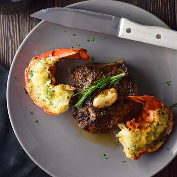 "<span class=""entry-title-primary"">Easy Surf and Turf for Two Recipe</span> <span class=""entry-subtitle"">Seared NY strip steak served with baked and buttered lobster tails.</span>"
