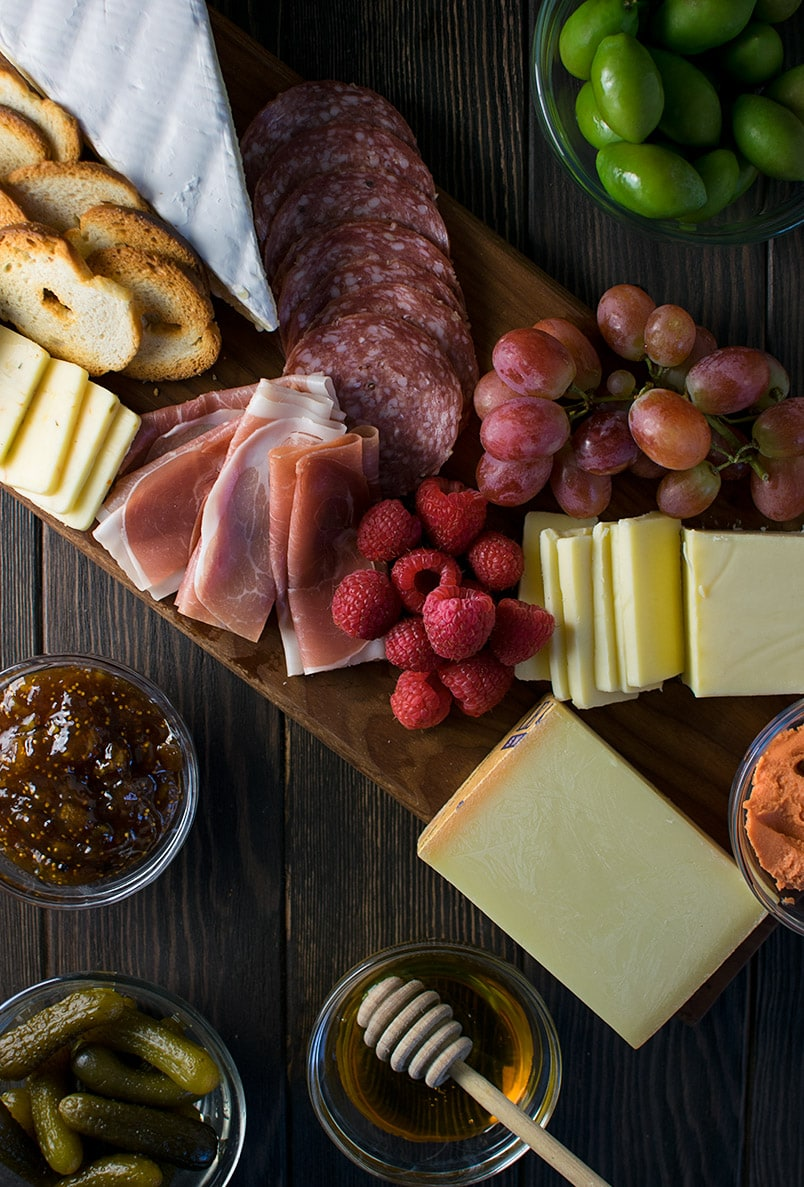 Our ideal charcuterie plate is made up of cheese, meat, and fruit.