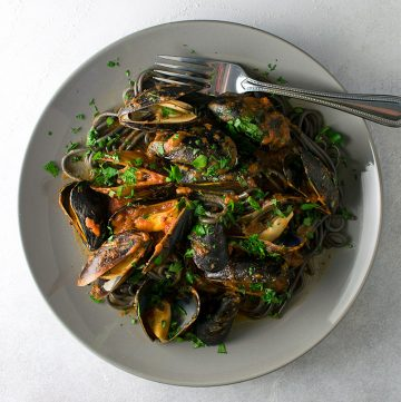 "<span class=""entry-title-primary"">Spicy Squid Ink Pasta with Mussels Recipe</span> <span class=""entry-subtitle"">Mussels prepared in a spicy arrabiata sauce over squid ink spaghetti.</span>"