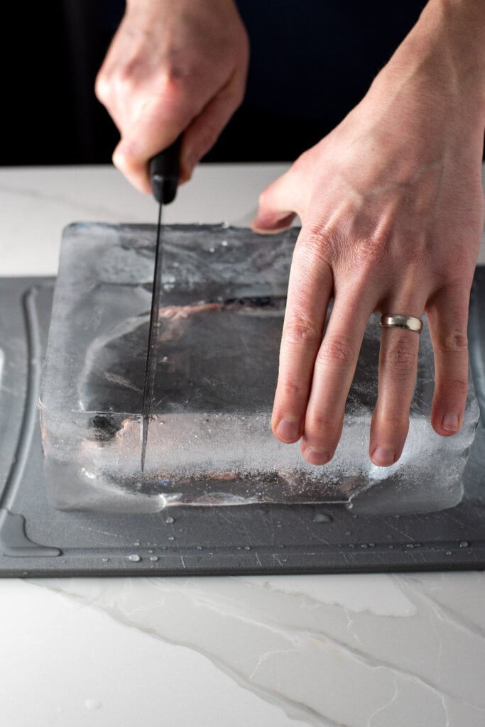 Cutting block of clear ice into columns