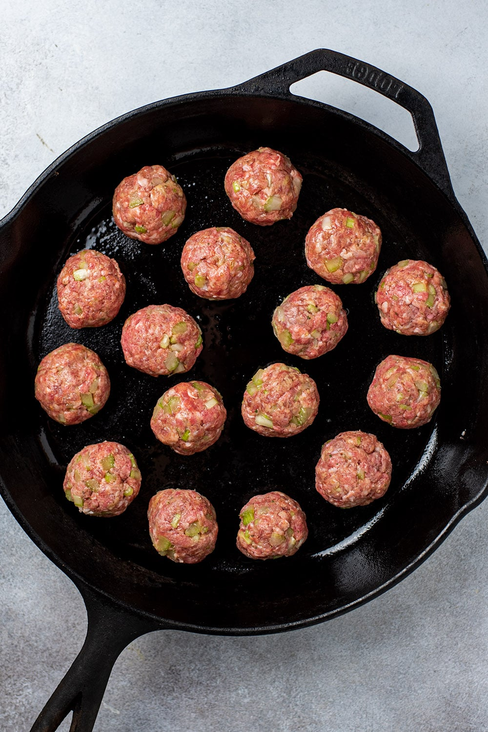Rolled meatballs in skillet